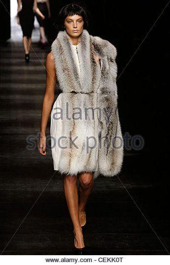Lanvin Paris Ready to Wear Autumn Winter Model wearing cream dress with fur trim, fur stole over shoulder - Stock Image