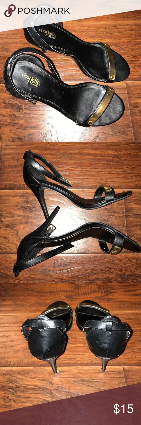 Size 10 black heels from Charlotte Russe Black and gold heel with strap around the ankle heals about 3 to 4 inches high. Some wear from normal use. Very cute gold design. Size 10 and brand Charlotte Russe Charlotte Russe Shoes Heels