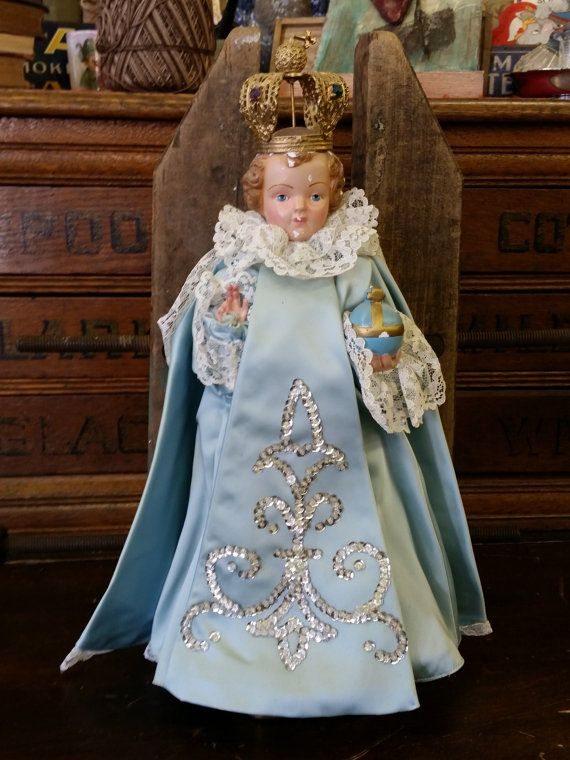Vintage Infant Of Prague Statue from Rustysecrets by rustysecrets on etsy... mine is also chalkware (Plaster) and chipped and mine is missing his crown. This crown is missing the blue liner matching the vestments. I'd dress following the liturgical seasons.