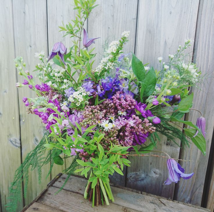 The Queensferry Flower Company.  Wild spring Lilac and Clematis Bridal Bouquet at Fingask Castle.