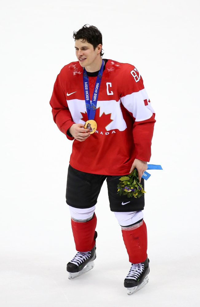 Sidney Crosby #87 of Canada celebrates with his gold medal following his team's 3-0 victory during the Men's Ice Hockey Gold Medal match against Sweden on Day 16 of the 2014 Sochi Winter Olympics at Bolshoy Ice Dome on February 23, 2014 in Sochi, Russia.