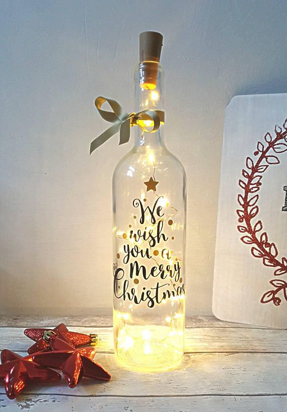 Christmas Lighting / Wine Bottle Christmas Lighting A wine bottle filled  with glowing lights and verse on the front we wish you a merry Christmas. - Christmas Lighting, Light Up Bottle, Christmas Lighting, Christmas