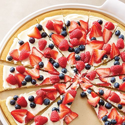 A crisp sugar cookie crust topped with sweetened cream cheese and fresh fruit, this dessert pizza is almost too pretty to eat!