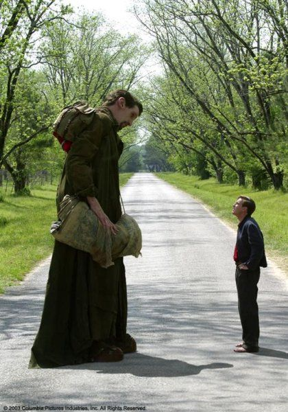 Edward (Ewan McGregor) and Karl the Giant (Matthew McGrory, died Aug 2005) decide the town Ashton just isn't big enough for either of them and plan to hit the road: from movie BIG FISH.