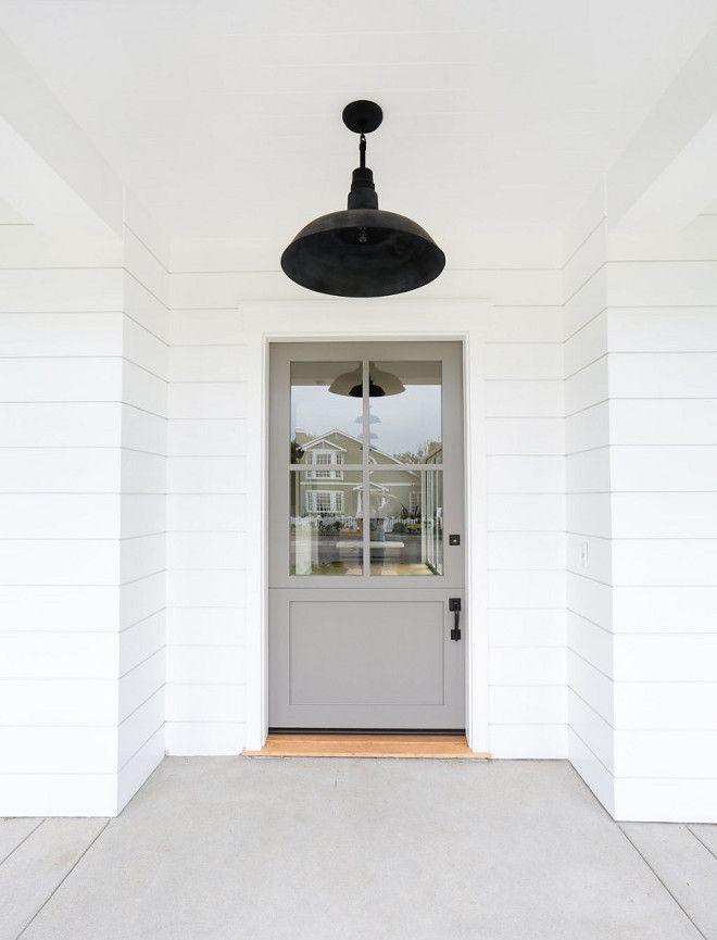 Galveston Gray Benjamin Moore paint color on front door of a beautiful home by The Fox Group. Barn style ceiling light. #thefoxgroup #benjaminmooregalvestongray #paintcolor #frontdoor #houseinspiration