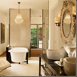 love how the chandelier over the tub draws your eye to the end of the room
