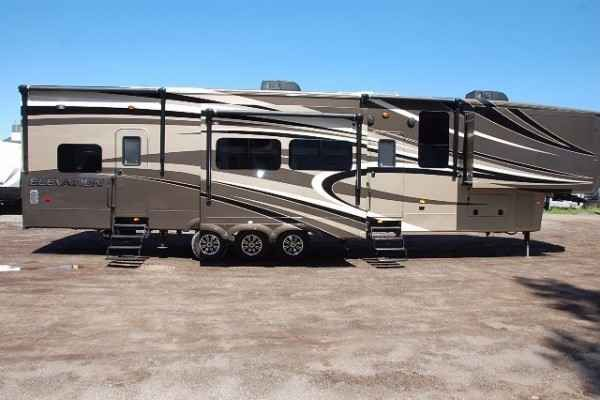 "2015 New Crossroads Elevation Las Vegas TF38LV Toy Hauler in Michigan MI.Recreational Vehicle, rv, 2015 CrossRoads Elevation Las Vegas TF38LV, Free Shipping First 1,000miles Only $609.74 per month with approved credit! Forget what you know about ""toy haulers"". The elevation is not just for those who haul quads, dirt bikes, and motorcycles. Smart design and floorplan innovation enable Elevation to excel at delivering multi-zone living, sophistication and your own personal style, wether you…"
