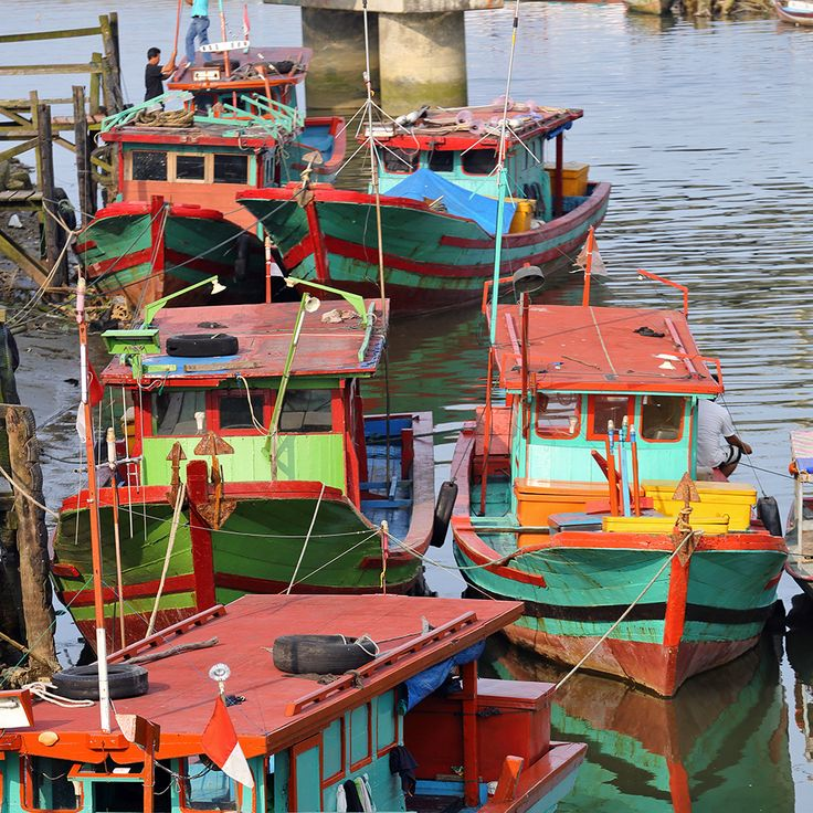 Colorful fishing boats in a river in Gunungsitoli, the main town on Nias Island. North Sumatra, Indonesia. Photos by Bjorn Svensson. www.visitniasisland.com