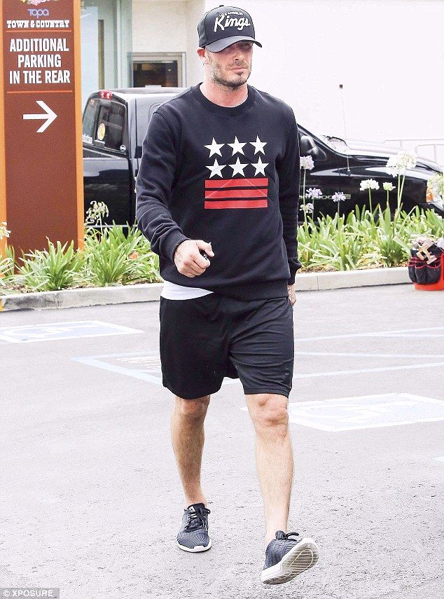 Daddy dearest: David Beckham was seen at the gym with his sons on Tuesday in LA black hockey baseball cap