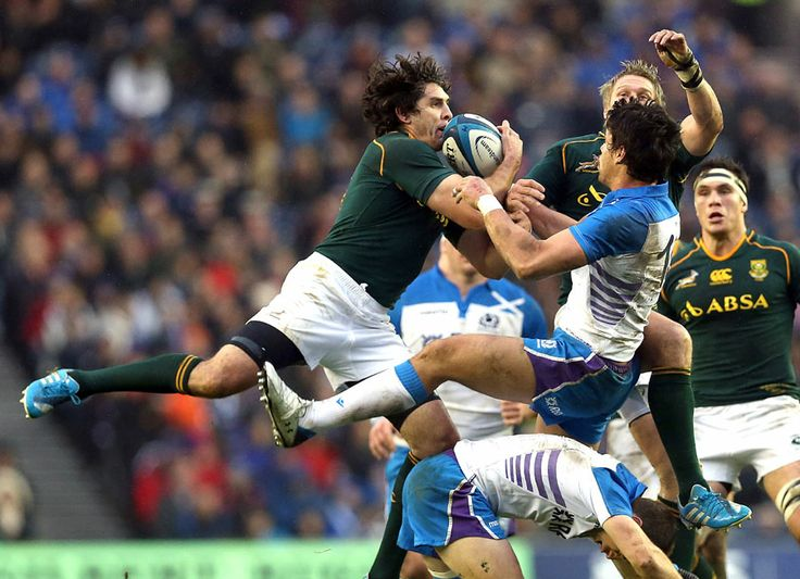 Willie le Roux jumps for the ball with Sean Maitland during South Africa's 28-0 drubbing of  Scotland