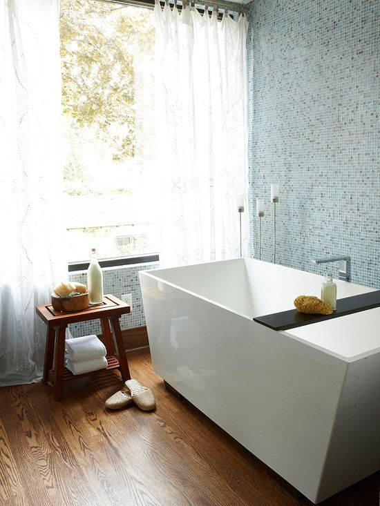 With clean lines and a rectangular shape, this spacious soaking tub is a reflection of modern style, which is repeated in the minimalist design of the tub filler positioned in the center of the tub. A sliding shelf, which fits around the edge of the tub, provides a spot for bathing essentials.
