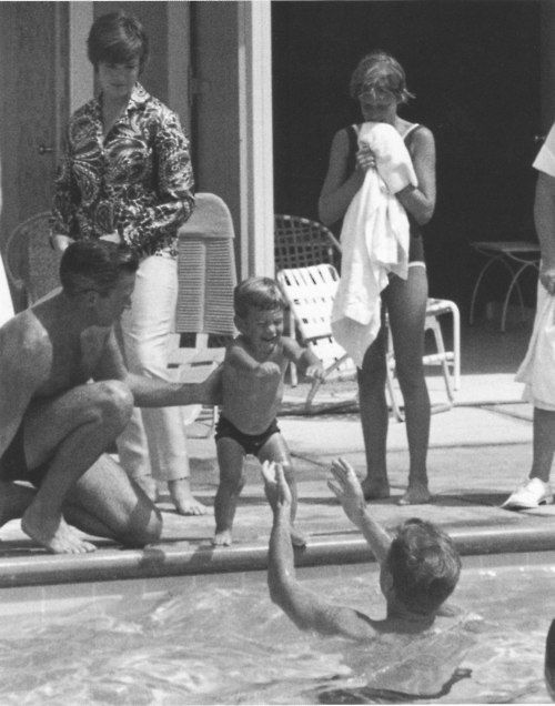 President Kennedy frolicked with his son at the Kennedy compound in Hyannis Port, urging him to take the plunge into the family swimming pool.