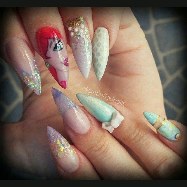 Instagram media by getbuffednails - Under the sea #full #Arielnails #getbuffednails #glitter #bling #disneynails #scales #mermaidnails #mermaid #3Dacrylic #bow #gelpolish #cutenails #handpainted #longnails #pointynails #nailprodigy #nailartdesigns #notd #instanails #ignails #nailswag #nailgamestrong