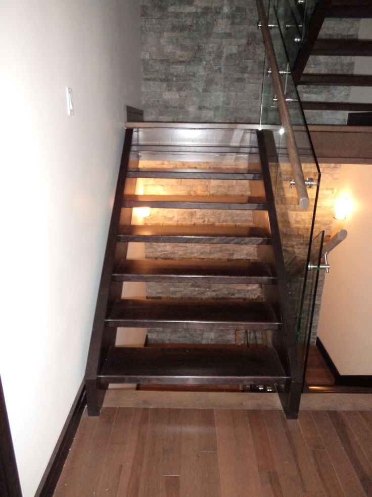 Custom built floating staircase with glass