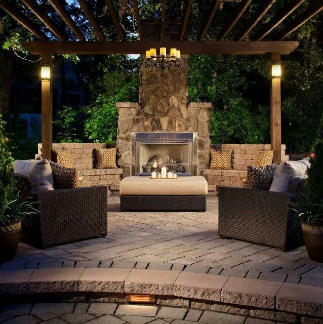 Someone amazing created not only a pergola and fire brick patio outdoor room situation, BUT ALSO a legit fireplace with brick benches attached! #HeavenSentMeAnAngel!