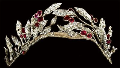 The Ruby Olive Wreath Tiara belonged to Queen Olga who left it to her son, Prince Nicholas. His daughter, Princess Olga of Yugoslavia, next inherited & loaned it to her sister, Marina, Duchess of Kent, for the coronation of Queen Elizabeth II. The Yugoslavian royals were exiled & the tiara sold to King Paul of Greece, Olga's cousin. Queen Friederike wore it during Paul's reign & gave it to new Queen Anne-Marie who took the tiara w/ her when the monarchy was deposed. She wears it regularly…