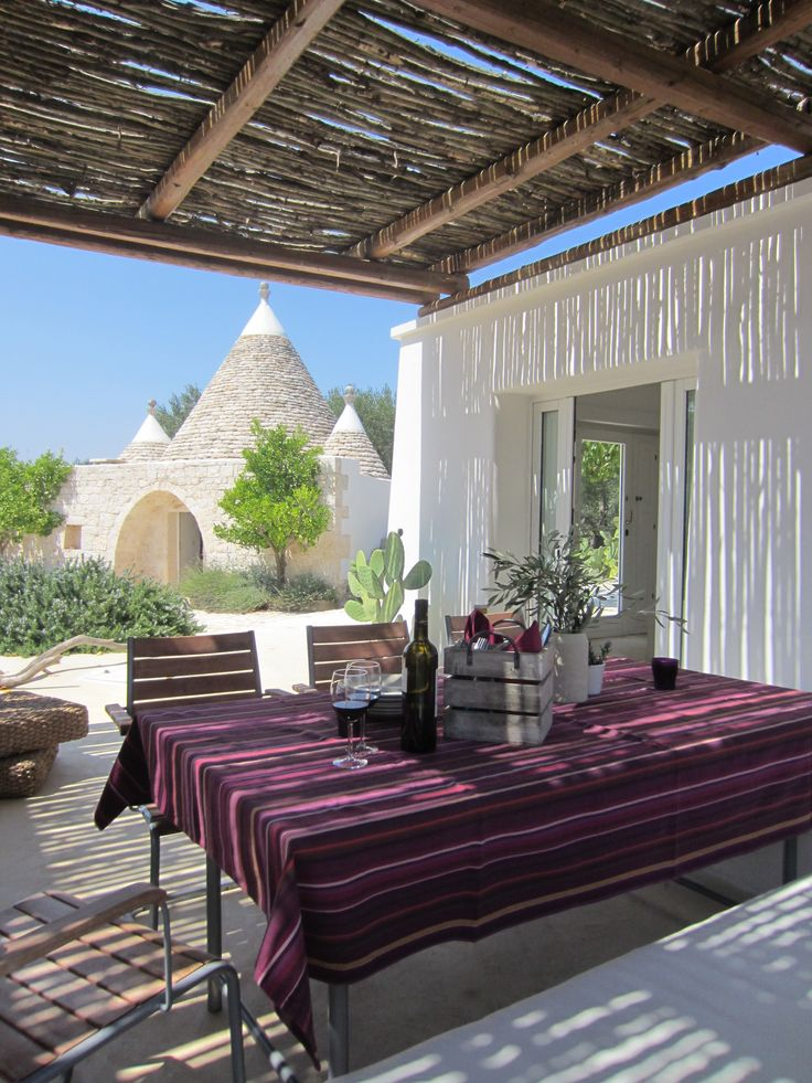 Trullo Gioia, a summer home under the Puglia sun in the heel of Italy.  Indoor and outdoor rooms where nature is always the protagonist