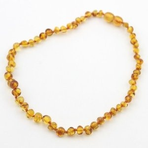 Baltic Amber Teething Necklace. Supposedly the oils from the amber serve as a natural pain reliever. All I know for sure is that my daughter has slept a lot better and seems to be less fussy during teething episodes since she started wearing this necklace. Plus, we get tons of compliments on it!