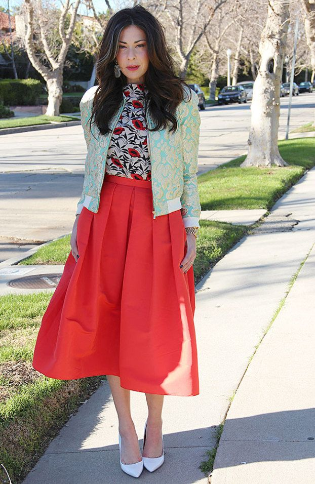 J. Crew blue and yellow bomber jacket + white, black, and red blouse + red midi skirt + white heels