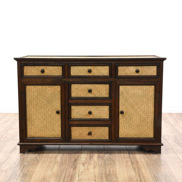 This buffet is featured in a solid wood with a glossy rosewood finish. This Asian style sideboard has 6 spacious drawers with woven panels, 2 bottom side cabinets with interior shelving, and bracket feet. Perfect for storing plates, pots, and pans! #asian #storage #buffet #sandiegovintage #vintagefurniture
