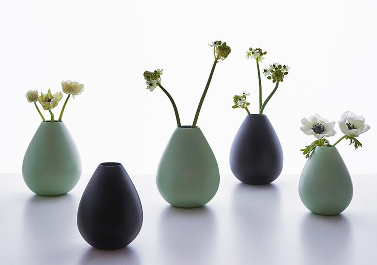 Favourite flowers in vases from the AJ Royal Vintage collection. Designed by Arne Jacobsen for the world's first design hotel The SAS Royal Hotel in Copenhagen from 1960.