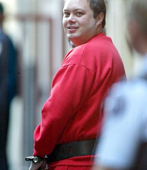 Carl Williams sentenced to life imprisonment, with a non-parole period of 35 years, for the murders  of Jason Moran, Lewis Moran and Mark Mallia. Here he is led from Melbourne Supreme Court  after a drug trafficking hearing in 2004. Picture: Richard Cisar-wright