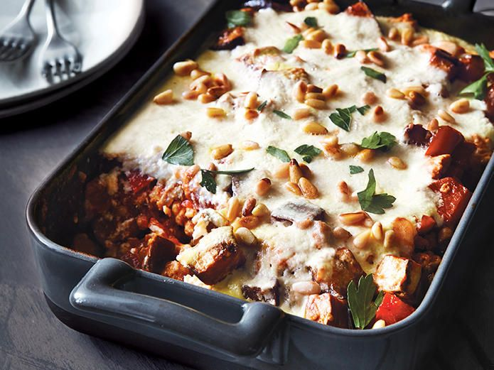 This Greek dish is similar to lasagna, but it's traditionally layered with eggplant, tomatoes, ground beef or lamb, and a béchamel sauce....
