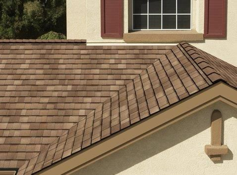 Brown roof with light colors on the exterior.