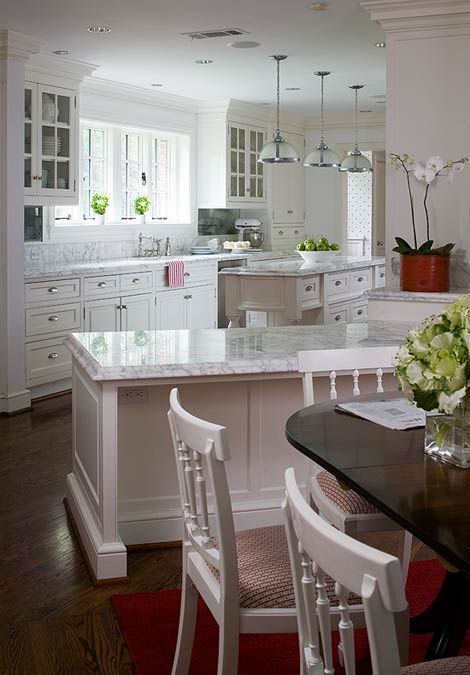 White gray countertops with old grey barnwood flooring - White kitchen red accents ...