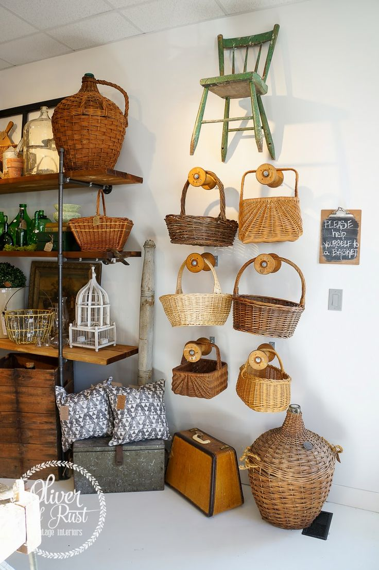 Oliver and Rust: We are Open: So how about a tour? Oliver and Rust Vintage Interiors... love those old wooden spools as hooks for baskets.