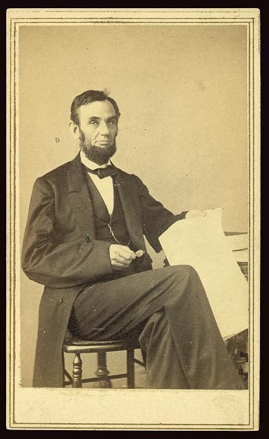 Seated pose of Abraham Lincoln holding Emancipation Proclamation papers. Photographed by Alexander Gardner. (c1863).