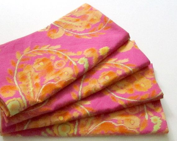 Gorgeous fiery orange and yellow on a bright hot pink background, in this bold Ikat print.  Machine wash and dry!  Shipping will be combined and
