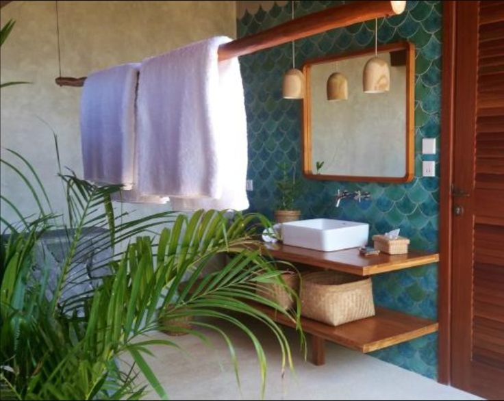 Fish scale time in tropical bathroom