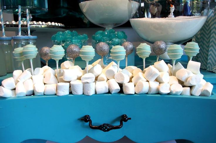 Frozen party table set up by The Simple Party Cake pops by Sugarpopbakery