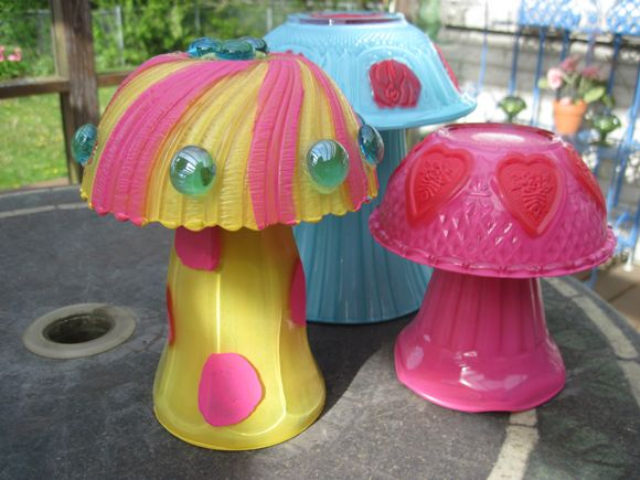 glass garden mushrooms...what a cute way to use that old glassware that you can easily find at yard sales!