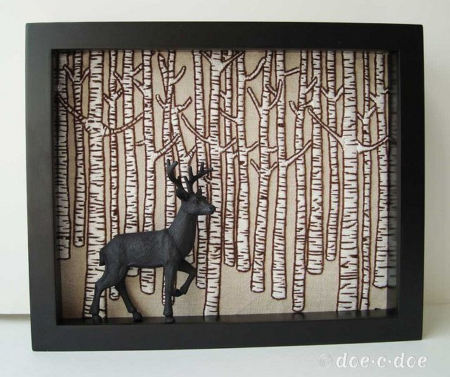 painted plastic animals in frames....would work as well with a photo backdrop too