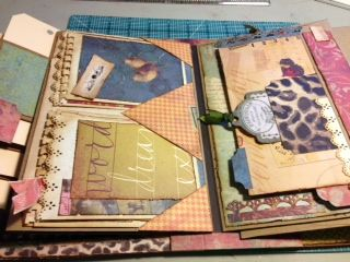 """Book of Memories - Follow the Paper Trail - February 2013 - Ustream tutorial is archieved on her blog (She did 3 versions; this one used a specialty paper """"Scribe"""" from K The tutorial also demos her Perfect Hinge."""