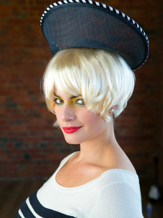 HELLO SAILOR | Navy Hat for Spring Racing Carnival | FORD MILLINERY  $295  This Jackie-O-esque beauty is simple, classic and perfectly teamed with navy, white and a splash of glacé-cherry red or canary yellow. Her navy, sinamay saucer disc base boasts an exaggerated upturned bow, and her navy & white twisted rope edge is sure to set your ship a'sailin'. Hair-comb fixture, with suggestion of additional hair-pins for those high-knot days. Hellooooooo, sailor!