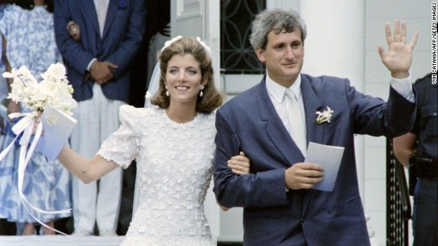 Kennedy and Edwin Schlossberg wave after their wedding ceremony in 1986.