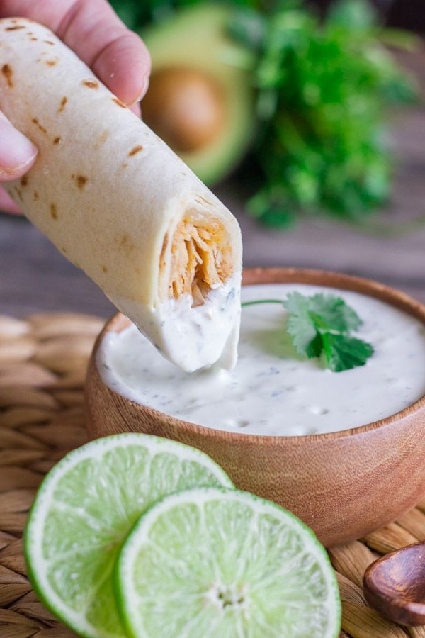 Sweet and spicy shredded chicken wrapped up in a crispy, crunchy baked tortilla with Cilantro Lime Cream for dipping