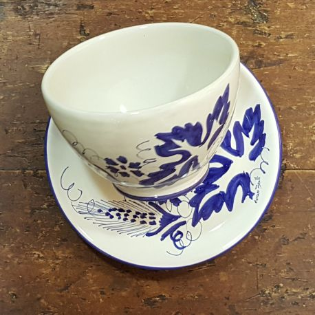 Bowl over ceramic saucer
