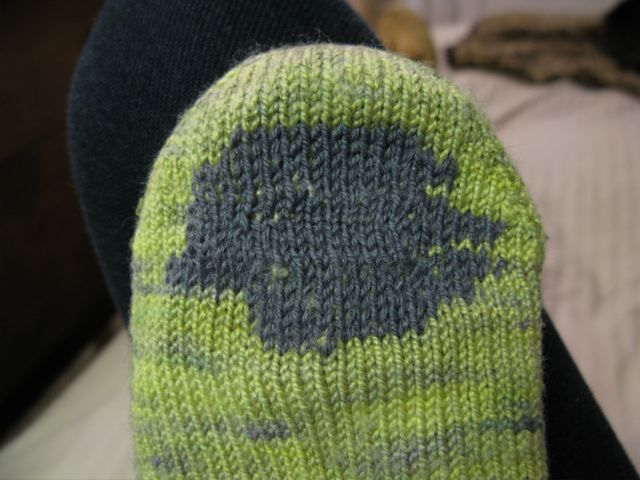 Knitted patch + duplicate stitch method  http://www.streetsandyos.com/archives/2010/02/darning_socks.php