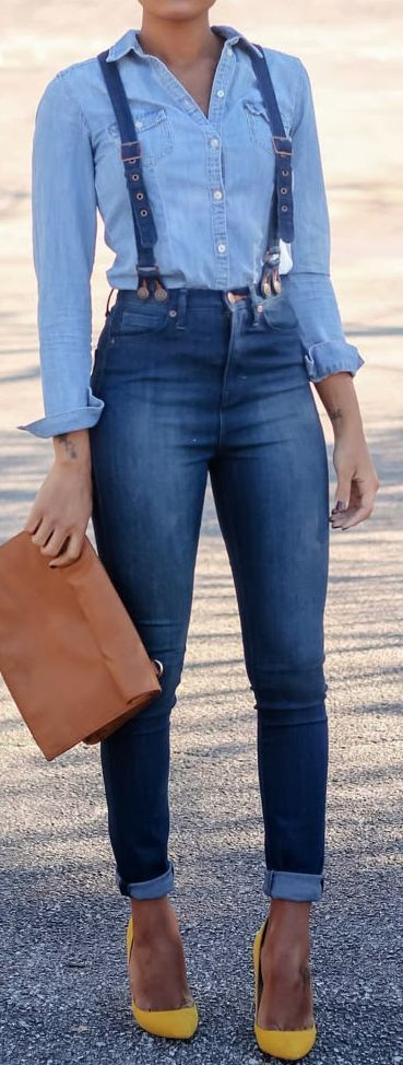 A nicely put together combination of a light blue denim shirt and blue skinny jeans will set you apart effortlessly. Take a classic approach with the footwear and opt for a pair of yellow suede pumps.   Shop this look on Lookastic: https://lookastic.com/women/looks/denim-shirt-skinny-jeans-pumps-clutch-suspenders/13450   — Light Blue Denim Shirt  — Blue Denim Suspenders  — Blue Skinny Jeans  — Brown Leather Clutch  — Yellow Suede Pumps