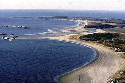 Popham Beach, Maine. You can walk out to that rock island at low tide. It's amazing. :)