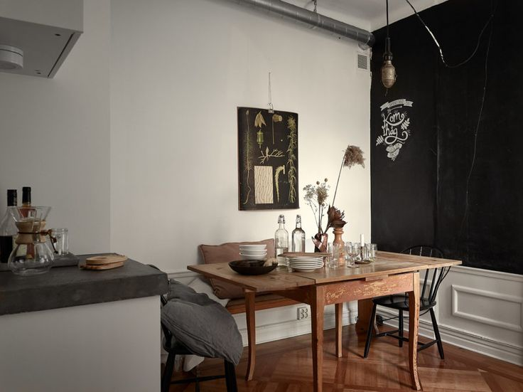 Beautiful kitchen in scandinavian style. Vintage furniture and black wall.