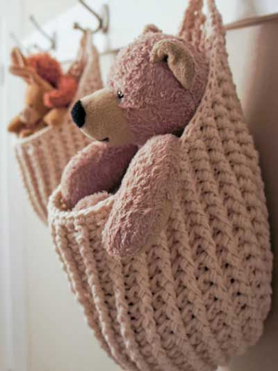 crochet Hanging Storage Pouch pattern, could also be done with a cute hat pattern and just add the handle row.