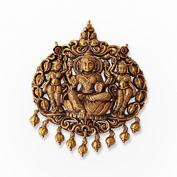 # A Gold Repousse Pendant, # Laxmi,#Jewels from South India | Saffronart.com