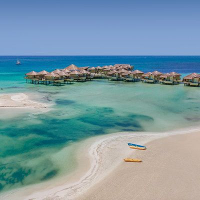 Overwater villas are no longer exclusive to South Pacific resorts: this resort recently debuted Mexico's first accommodations perched above the Caribbean.