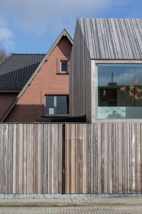 """Declerck-Daels Architecten used different varieties of timber and """"frivolous"""" colours for this surgery in Bruges."""