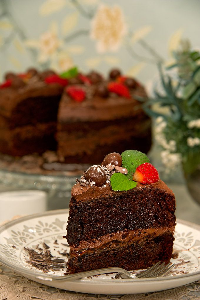 "#CafeMozart says ""Let them eat cake!"" Delectable chocolate cake topped with whispers. #cake #chocoholics #dessert"